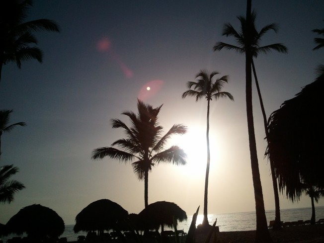 A walk at sunrise on Bavaro Beach, Punta Cana, Dominican Republic.